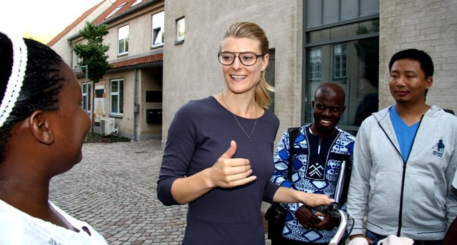 Danish MP Ane Halsboe-Jørgensen discusses democracy with course participants outside Danida Fellowship Centre at Frederiksberg.