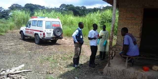 Dr John Ekow Otoo (in blue) working in Kailahun which was the first district that recorded no new cases of Ebola in Sierra Leone.