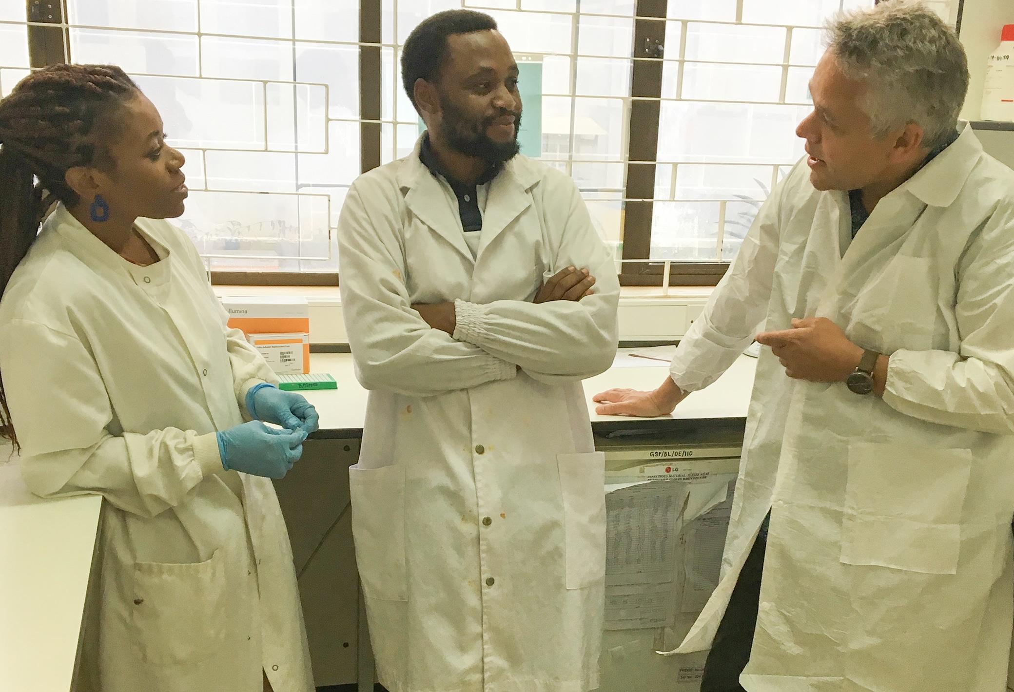 Tolbert Sonda and Happy Kumburu, with Michael Alifrangis (CMP, University of Copenhagen) in main laboratory of KCMUC