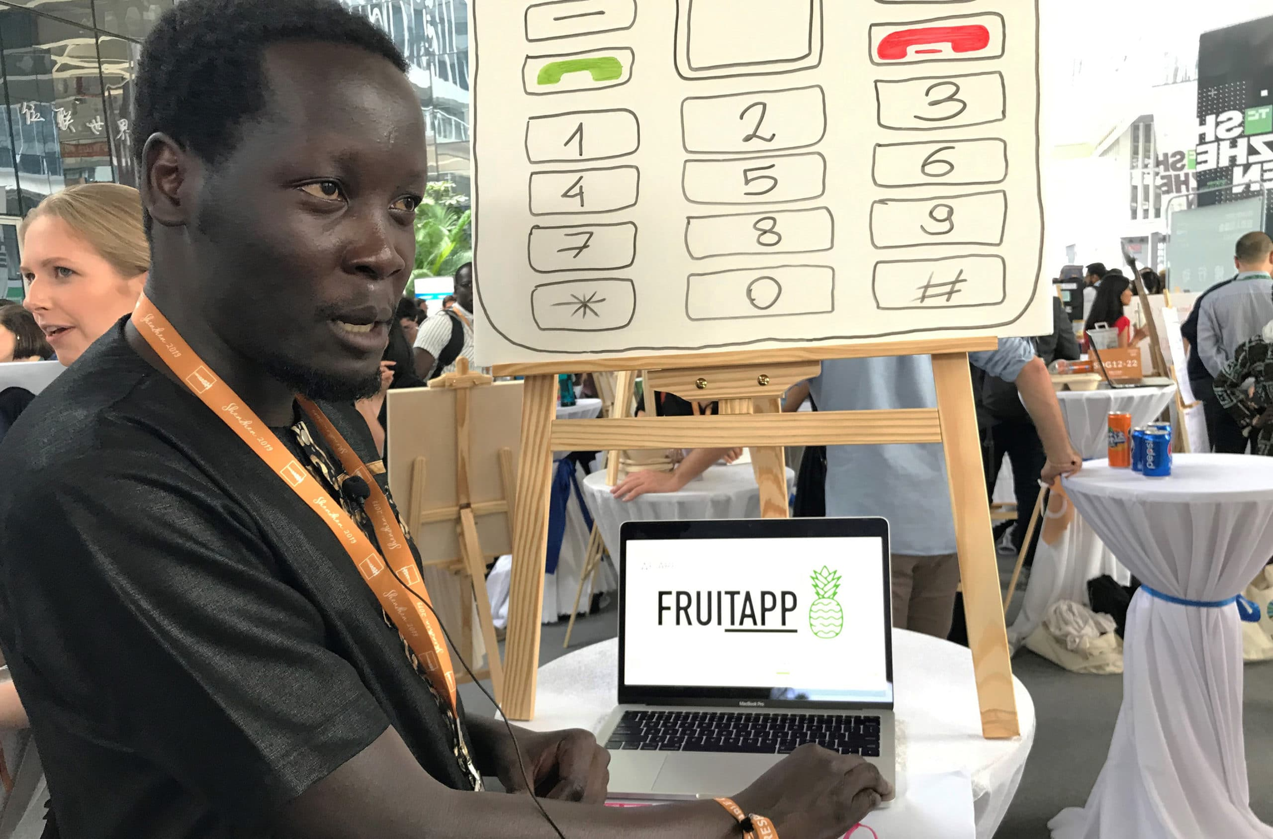 "Peter Okwoko shares his team's solution ""FruiTAPP"" at the UNLEASH Market Place. Photo: Nina Vlemmings."